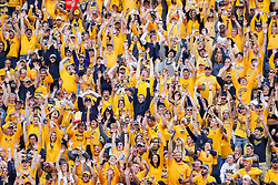 """Sep 22, 2018; Morgantown, WV, USA; West Virginia Mountaineers fans take part in the """"wave"""" during the fourth quarter against the Kansas State Wildcats at Mountaineer Field at Milan Puskar Stadium. Mandatory Credit: Ben Queen-USA TODAY Sports"""