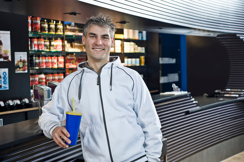 Smiling man at the bar of a gym