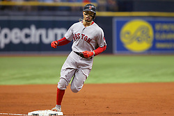 May 22, 2018 - St. Petersburg, FL, U.S. - ST. PETERSBURG, FL - MAY 22: Xander Bogaerts (2) steps on third base after hitting a home run during the MLB regular season game between the Boston Red Sox and the Tampa Bay Rays on May 22, 2018, at Tropicana Field in St. Petersburg, FL. (Photo by Cliff Welch/Icon Sportswire) (Credit Image: © Cliff Welch/Icon SMI via ZUMA Press)