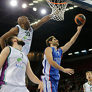 Anadolu Efes's Stratos Perperoglou (C) and Unicaja Malaga's Caleb Green (2ndL) during their Turkish Airlines Euroleague Basketball Top 16 Round 2 match Anadolu Efes between Unicaja Malaga at Abdi ipekci arena in Istanbul, Turkey, Friday January 09, 2015. Photo by Aykut AKICI/TURKPIX