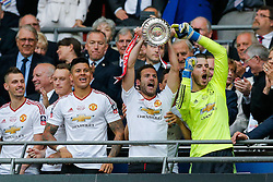 Goalscorer Juan Mata and David De Gea of Manchester United celebrate after winning the FA Cup with a 1-2 victory after the game went to extra time - Mandatory byline: Rogan Thomson/JMP - 21/05/2016 - FOOTBALL - Wembley Stadium - London, England - Crystal Palace v Manchester United - FA Cup Final.