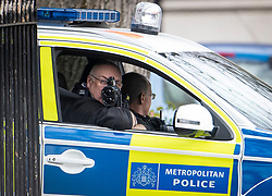 © Licensed to London News Pictures. 02/04/2020. London, UK. Police officers speed check vehicles travelling around Regents Park in London, during a pandemic outbreak of the Coronavirus COVID-19 disease. Members of the public have been told they can only leave their homes when absolutely essential, in an attempt to fight the spread of COVID-19. Photo credit: Ben Cawthra/LNP