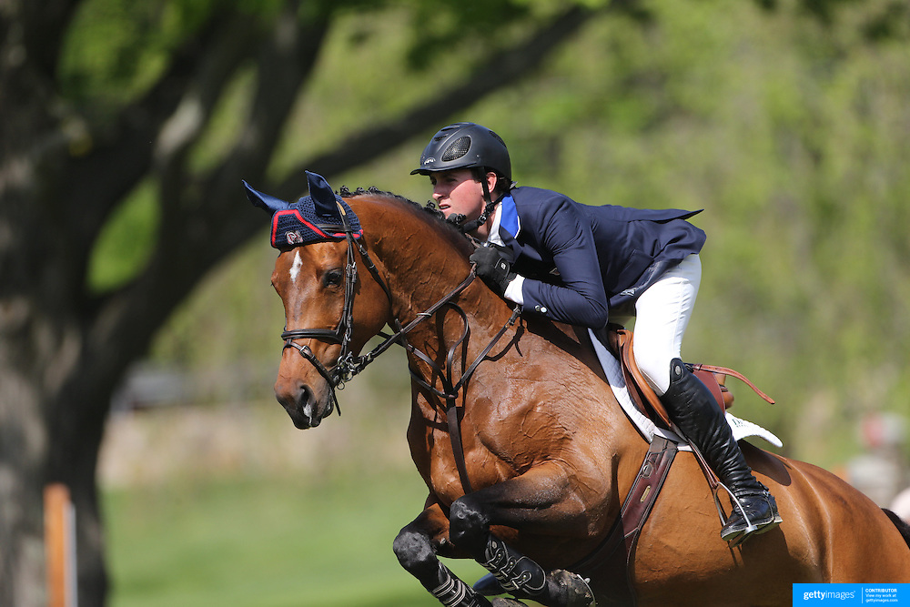 Michael Hughes riding Luxina in action during the $100,000 Empire State Grand Prix presented by the Kincade Group during the Old Salem Farm Spring Horse Show, North Salem, New York,  USA. 17th May 2015. Photo Tim Clayton