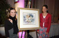 Left to right, DARCY KING and NATASHA HAMPTON at a reception to launch Angel themed Christmas Cards and view an exhibition of the original art work by Gordon King with proceeds going to the Caron Keating Foundation  held at the Langham Hotel, Portland Place, London on 20th November 2006.<br />