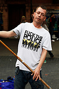 T-shirt reads 'Fuck the police'. Peaceful demonstration in central London by protesters during the TUC union march against cuts, Saturday March 26th 2011. Around 400,000 people joined the TUC's March for the Alternative to oppose the coalition government's spending cuts. Teachers, nurses, midwives, NHS, council and other public sector workers were joined by students and pensioners to bring the centre of the capital to a standstill and to make their point that the current coalition government is making cuts too fast which they suggest will have a catastrophic effect on jobs and economic recovery.
