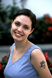 Jan 17, 1998 - Hollywood, California, U.S. - Actress ANGELINA JOLIE during private photo shoot and interview outside in a garden. (Credit Image: © Armando Gallo via ZUMA Studio)