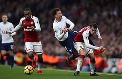 Tottenham Hotspur's Dele Alli is sent flying under the challenge of Arsenal's Granit Xhaka (right)