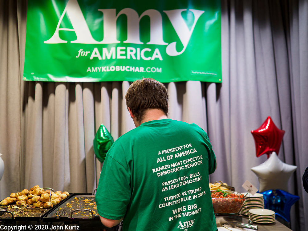 03 FEBRUARY 2020 - DES MOINES, IOWA: A man at the food table during Sen. Klobuchar's caucus night party at the downtown Marriott Hotel in Des Moines. The party was her last Iowa appearance of the primary season. Iowans made the first presidential selection picks of the 2020 election campaign with the Iowa caucuses Monday night.   PHOTO BY JACK KURTZ
