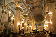 Interior of the Bastia Cathedral with tourists in the Citadelle on 16th September 2017 in Bastia, Corsica, France. Bastia is a French commune in the Haute-Corse department of France located in the north-east of the island of Corsica at the base of Cap Corse. Bastia is the principal port and commercial town of the island. The inhabitants of Bastia are known as Bastiais or Bastiaises. Bastia Cathedral Pro-cathédrale Sainte-Marie de Bastia is a former Roman Catholic cathedral in Bastia on the island of Corsica, and a national monument of France. The former Bastia Cathedral, dedicated to Saint Mary, was built from 1495 onwards, with major reconstruction at the beginning of the 17th century. Behind the church stands the chapel of Sainte-Croix, known for its exuberantly decorated interior and for the figure of Christ des Miracles Christ of the Miracles, venerated by the people of Bastia, and discovered floating in the waters of the Mediterranean in 1428.