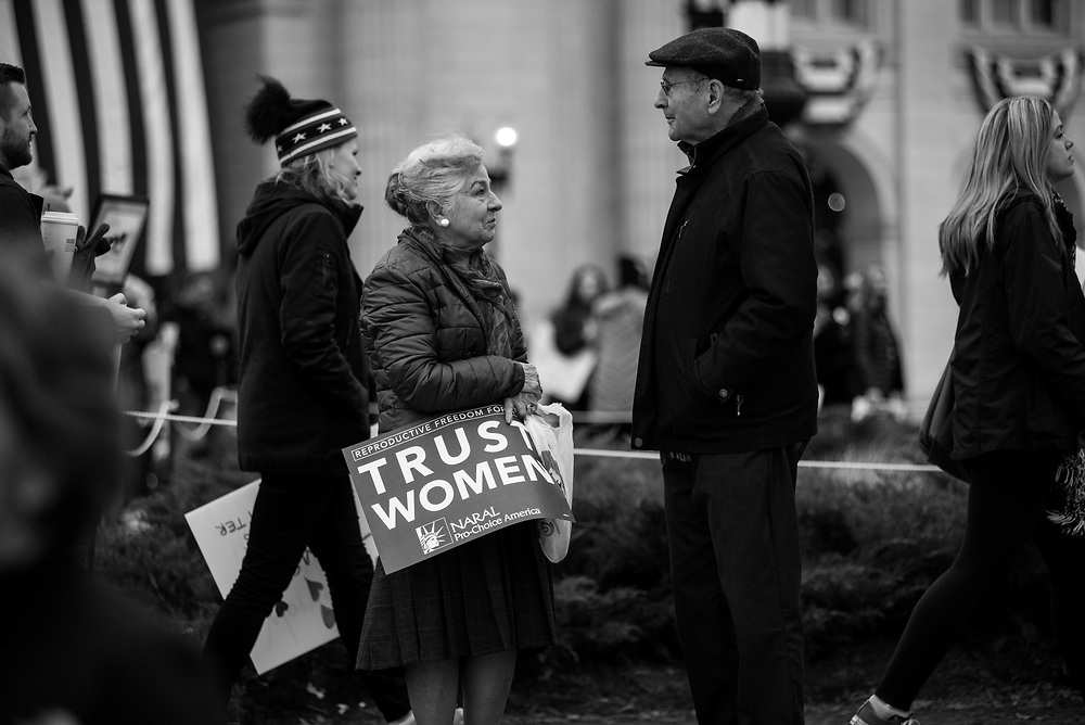 Couple waiting at Union Station, Washington, DC, before heading to the Women's March, January 20, 2017.