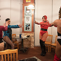The drag troupe Blackout rehearse before the start of Diné Pride's Queen of Hearts Dance and Drag Show Saturday night at Sammy C's Rock N' Sports Pub & Grille in Gallup.