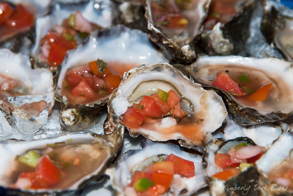 A delicious plate of Pacific oysters on the half shell from Tomales Bay, California, dressed with mignonette sauce.