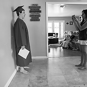 Erin records Spencer's 8th grade graduation speech. Spencer was one of three students who were asked to submit a speech to be played during the virtual commencement. Spencer at times grew frustrated trying to remember the lines to the speech.