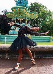 Edinburgh, Scotland, UK; 1 August, 2018. Cuban ballerina Beatriz Torres Cuellar performs in Princes Street Gardens during opening day of the Edinburgh Fringe Festival