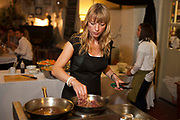 "Frying steak. Radio DJ Sara Cox 'does a Delia' hosting a pop up supper for Oxfam<br /> Radio DJ Sara Cox swaps her microphone for an oven to host a special one off pop up restaurant with Oxfam.  <br /> The popular radio one DJ cooked a South American themed three course dinner for guests at Hackney City Farm in London.  Co-hosted with Oxfam, Sara entertained a varied group of diners including fellow DJs, well known food bloggers and local food producing heroes.<br /> Sara Cox said: ""I love cooking and entertaining people so I'm really happy to be 'doing a Delia' and swapping a radio studio for a kitchen for the night to cook up a South American supper for my guests.  Hosting the event is a fun and creative way for me to show my support for Oxfam's campaign to share the world's food resources more fairly and eradicate hunger."""