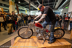 Brian Buttera kickstarts his custom Harley-Davidson Shovelhead that won him this trip to the Swiss-Moto show when he won the Rat's Hole Show in Sturgis last summer. The icing on the cake was that he won Best of Show at this Swiss Moto, which won him another trip, this time to the upcoming Custom Show Emirates in Abu Dhabi. (and Brian just got his first passport ever!) Photographed at the Swiss-Moto Customizing and Tuning Show. Zurich, Switzerland. Saturday, February 23, 2019. Photography ©2019 Michael Lichter.