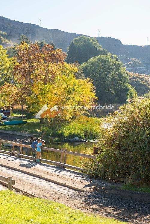 Two little boys on bridge looking at fish Ritter Island, Thousand Springs Art Festival, Hagerman, Idaho. MR