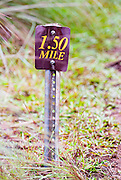 A marker on a trail marks the 1.5 mile point.