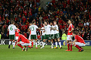 Rep of Ireland players celebrate win as Wales players stand and can't bear to look as they are dejected at final whistle after losing the match and their world cup dream is over. Wales v Rep of Ireland , FIFA World Cup qualifier , European group D match at the Cardiff city Stadium in Cardiff , South Wales on Monday 9th October 2017. pic by Andrew Orchard, Andrew Orchard sports photography