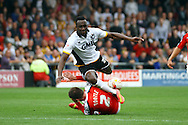 Port Vale's Jordan Slew is tackled by Crewe Alexandre's Matt Tootle. Skybet football league one match, Crewe Alexandra v Port Vale at the Alexandra Stadium in Crewe on Saturday 13th Sept 2014.<br /> pic by Chris Stading, Andrew Orchard sports photography.