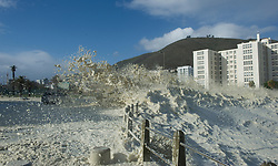 South Africa - Cape Town - 13 July 2020 - Thick foamy waves smash the wave breaks on the corner of Helen Suzman and Beach roads in Seapoint. SA Weather has warned the public of inclement weather for a period of time all across South Africa. Picture Courtney Africa/African News Agency(ANA)