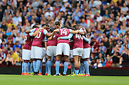the Aston Villa players huddle together before the match starts. EFL Skybet championship match, Aston Villa v Rotherham Utd at Villa Park in Birmingham, The Midlands on Saturday 13th August 2016.<br /> pic by Andrew Orchard, Andrew Orchard sports photography.