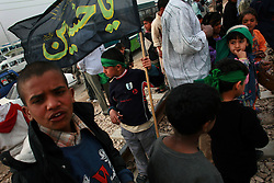 Hundreds of thousand of Shia pilgrims - many of them women and childre - set out from Baghdad walking towards the Shia holy city of Karbala on Sun. Feb. 24, 2008 during the Shia observance of Arbaeen which marks the end of 40 days of mourning after the murder of Imam Hussein - the grandson of the Prophet Mohammed and central figure in Shia Islam. This day pilgrims in Baghdad and south of Karbala were attacked by insurgents leaving nearly 50 dead and wounded.