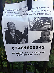 A poster with a picture of Khadija Saye on, one of those reported missing, close to the scene after a fire engulfed the 24-storey Grenfell Tower in west London yesterday.