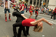 Same-sex partner dance group in the 2011 Pride Parade in New York.