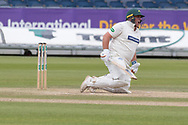 Mark Cosgrove felled by Ben Raine during the Specsavers County Champ Div 2 match between Durham County Cricket Club and Leicestershire County Cricket Club at the Emirates Durham ICG Ground, Chester-le-Street, United Kingdom on 21 August 2019.