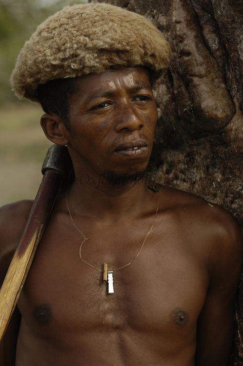 Antandroy man wearing hat made from goat skin. These traditional hats are now rare to see. These 'people of thorns' live in the 'spiny' forests of Southern MADAGASCAR. <br />THREATENED HABITAT<br />MADAGASCAR