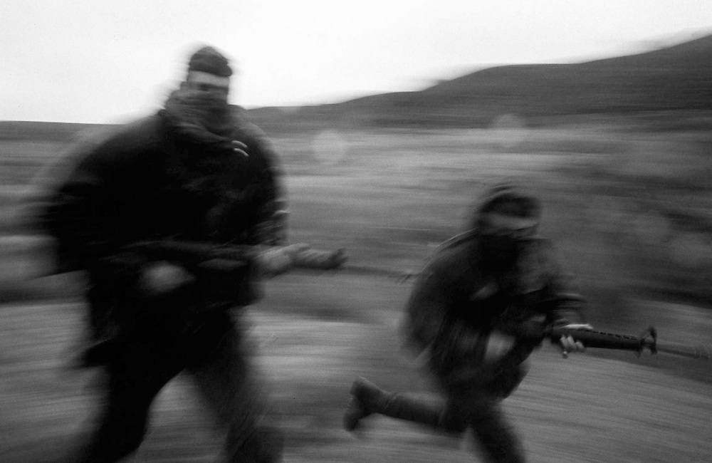 The SAS, Special Air Service of the British Army, an elite regiment seen out training on the Brecon Beacons, Wales, UK in 1970. This area is extremely familiar to them as it is used for their 'hills' selection phase to join the elite regiment. The trooper on the left is holding a modified L1A1 SLR and on the right the trooper holds a M16 assault rifle.  Photographed by Terry Fincher