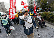 Disabled union activists at a left-wing Rally march against the exploitation of farmers during the construction of Narita Airport. Tokyo, Japan. Sunday March 23rd 2014. The main organiser of the protest was The Farmers' League Against Narita Airport. Around 1,000 activists from this league and other unions took part.