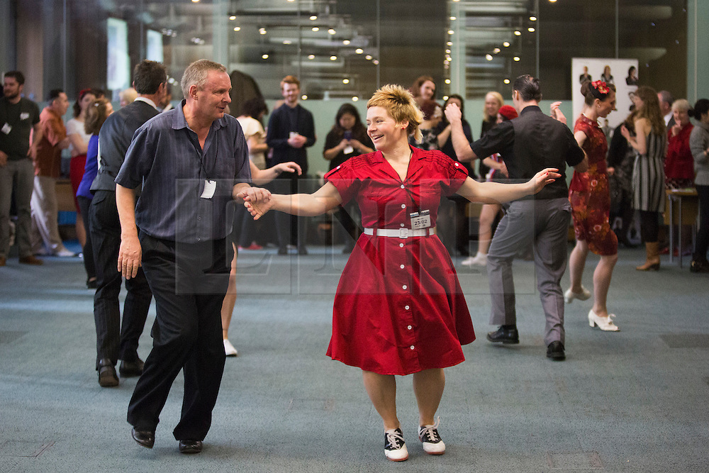 © Licensed to London News Pictures. 23/02/2015. London, England. MPs attend a dance class with members of Dance UK and Lindy Hop dancers. Dance UK launches the 2015 Dance Manifesto with a beginners' social dance class hosted by the All Party Parliamentary Dance Group for all MPs at Portcullis House and led by teacher Jenny Thomas, charleston choreographer for the BBC's Strictly Come Dancing with Strictly professional dancer Robin Windsor. Photo credit: Bettina Strenske/LNP
