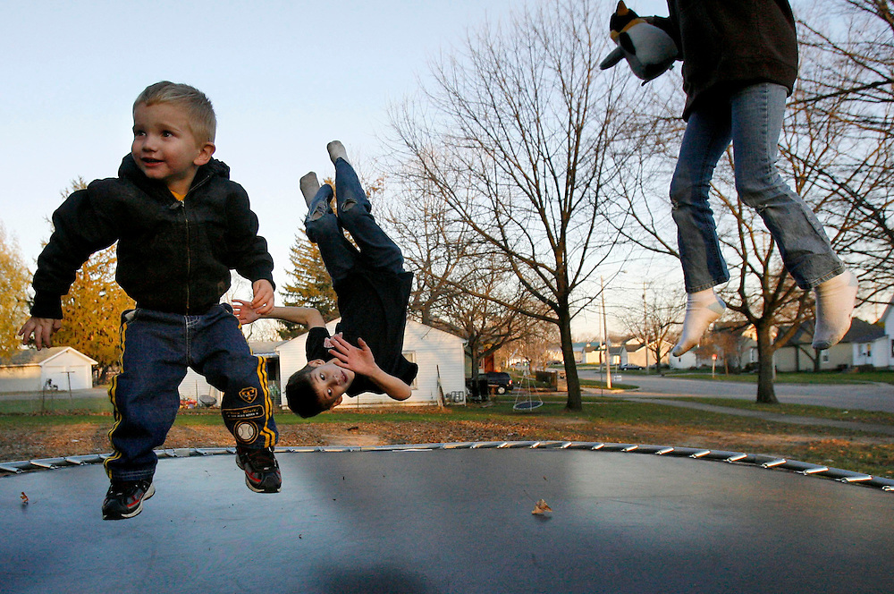 Seth Chapmann, 2, left, along with brother Seth Chapman, 9, center, and sister, Alexia Chapman, 8, right, jump on a trampoline next to  their home in Manchester on Thursday, November 5, 2009. (Crystal LoGiudice/The Gazette).