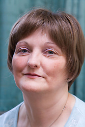 Woman; who has been undergoing Chemotherapy for breast cancer; wearing a wig to cover up hair loss as a result of the treatment,