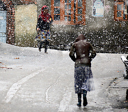 Kashmiri girls walk during the snowfall to enjoy the snow in Srinagar, the summer capital of Indian controlled Kashmir. Kashmir witnessed its first snowfall.