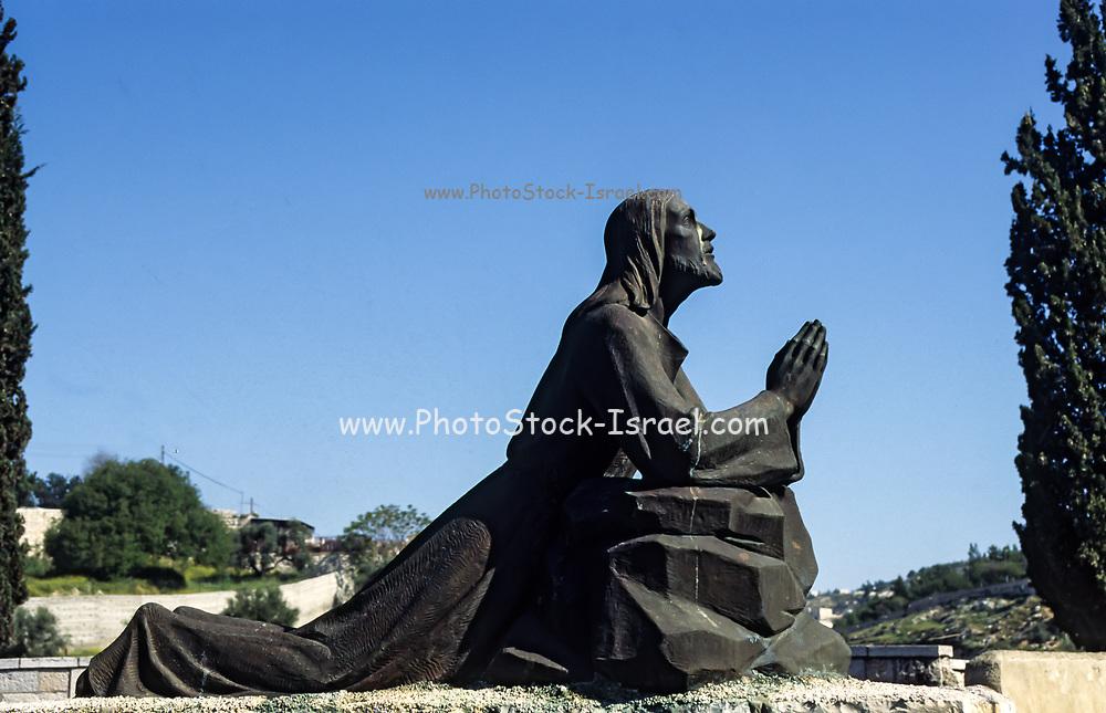 Statue of Jesus Christ praying in Gethsemane, Mount Olives Jerusalem, Israel