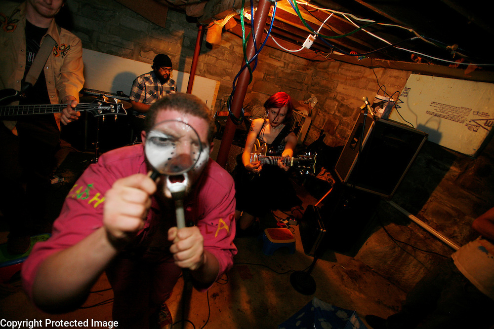 """Shane, of Cyn Cyn and the Pons, of Wisconsin, performs in the basement of """"House Gone Wylie."""""""