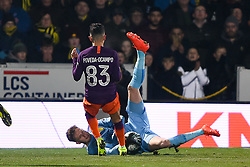 January 23, 2019 - Burton-Upon-Trent, Staffordshire, United Kingdom - Burton Albion goalkeeper Bradley Collins (40) makes the ball safe with Manchester City forward Ian Carlo Poveda (83) closing during the Carabao Cup match between Burton Albion and Manchester City at the Pirelli Stadium, Burton upon Trent on Wednesday 23rd January 2019. (Credit: MI News & Sport) (Credit Image: © Mark Fletcher/NurPhoto via ZUMA Press)