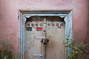 Xinjiang, China. Traditional Uighur frontdoor. <br /> Some doors of Uighur houses are marked with signs imposed by the government to 'tidy', 'educated' and 'civilized' households. NATACHA DE MAHIEU