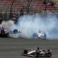 26-27 June, 2015, Fontana, California USA<br /> Takuma Sato and Will Power crash on the front straight<br /> ©2015, Phillip Abbott<br /> LAT Photo USA