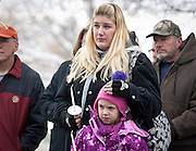 Alicia Caldwell holds her daughter Maggie Boren, both originally from Newtown, Conn., during the community dedication of a grove of trees at the Salt Lake City cemetery in remembrance of victims of the Sandy Hook Elementary shootings, Thursday, Dec. 27, 2012.