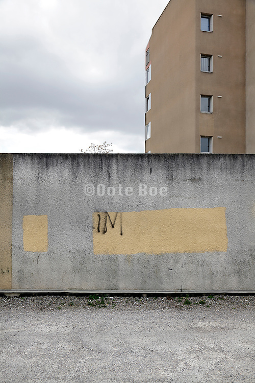 urban residential area with graffiti on a wall
