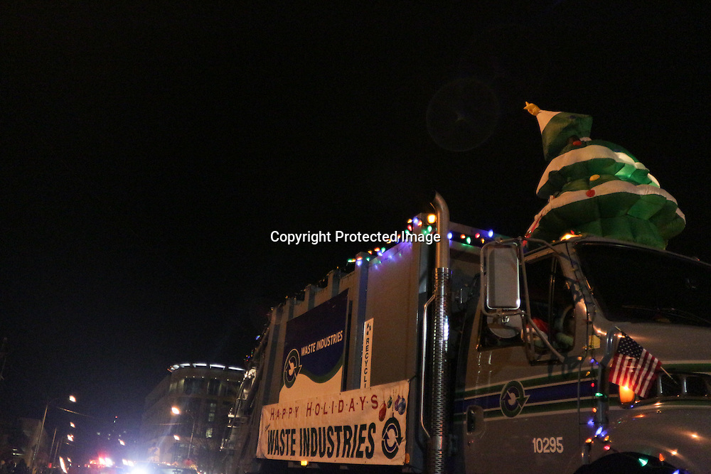 Waste Industries participates in the 12th Annual Wilmington Holiday Parade Sunday December 7, 2014 in Wilmington, N.C. (Jason A. Frizzelle)