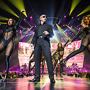 """WASHINGTON, DC - September 13, 2014 - Pitbull performs at the Verizon Center in Washington, D.C. The rapper, who's hits include the #1 singles """"Give Me Everything"""" and """"Timber"""", will release his eighth studio album, later this year. (Photo by Kyle Gustafson / For The Washington post)"""