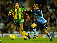 Photograph: Scott Heavey.<br />Coventry v West Bromwich Albion. Nationwide Division One. 20/12/2003.<br />Joost Volmer runs away from Michael Doyle