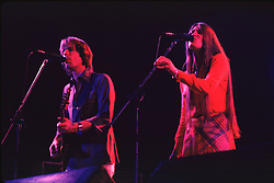 Bob Weir and Donna Godchaux performing with the Grateful Dead in Concert at the Huntington Civic Center, Huntington West Virginia on 16 April 1978. Image No. 78C16-12