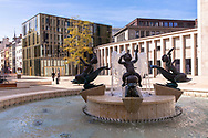 the Gerling Quartier, fountain with four boys riding on dolphins by artist Arno Breker at the Gereonshof, Cologne, Germany.<br />