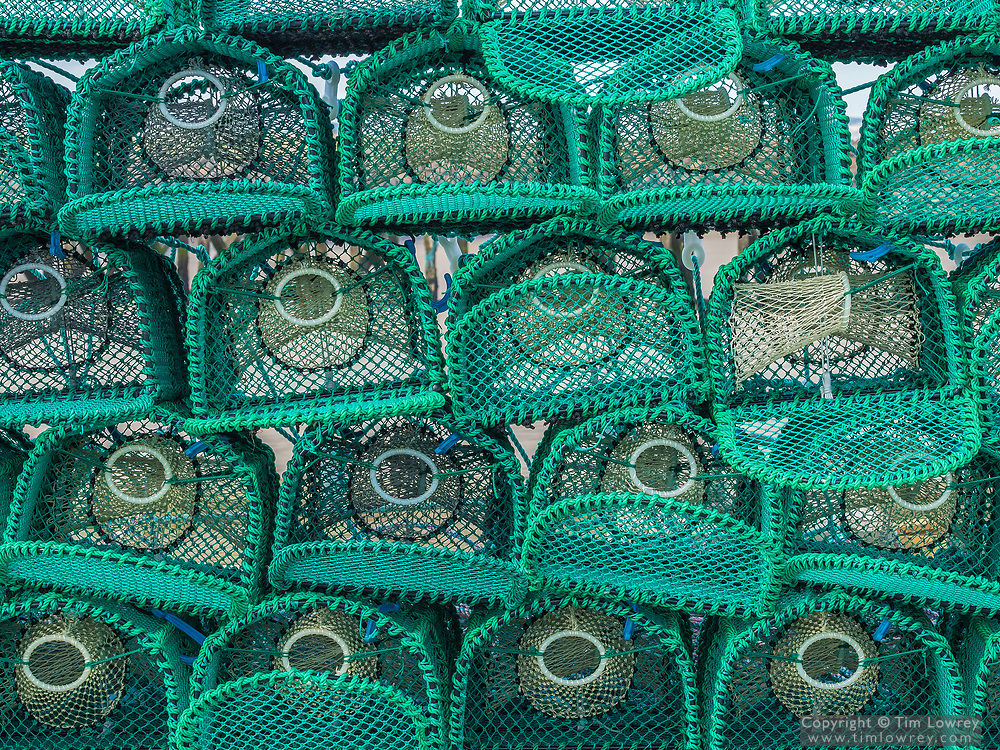 New Lobster Pots Stacked On The Harbour At The Costal Town Of Amble, Northumberland